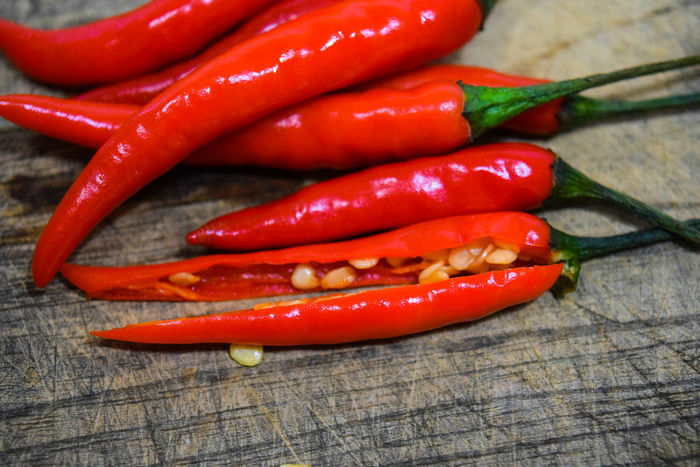 Chilli is a friend of your weight Black Peppercorn Chili Pepper Close-up Day Food Food And Drink Freshness Green Chili Pepper Healthy Eating Indoors  Ingredient No People Red Red Chili Pepper Spice Table Vegetable Wood - Material พริก พริกขี้หนู