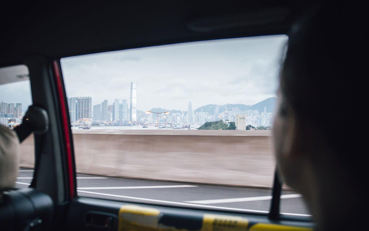 Close-Up Of Cityscape Seen Through Car Window