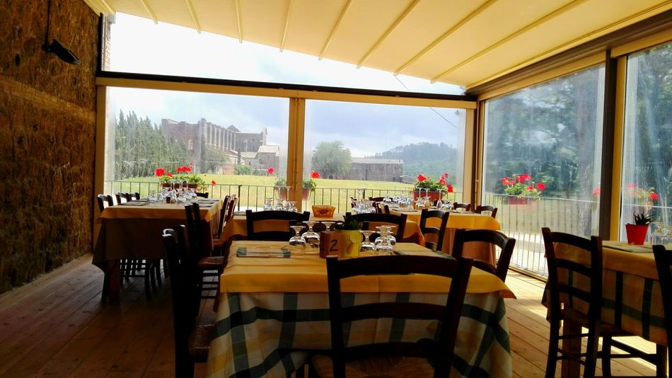 Tuscany life Chair Window Indoors  Table Glass - Material Transparent Restaurant Absence Empty Arrangement Food And Drink Industry Day Sky Flower Arrangement Landscape Toscana Tuscany Landscape Branch Tranquility Tuscany Sangalgano Abbey Tuscanylife Tuscany View Beauty In Nature