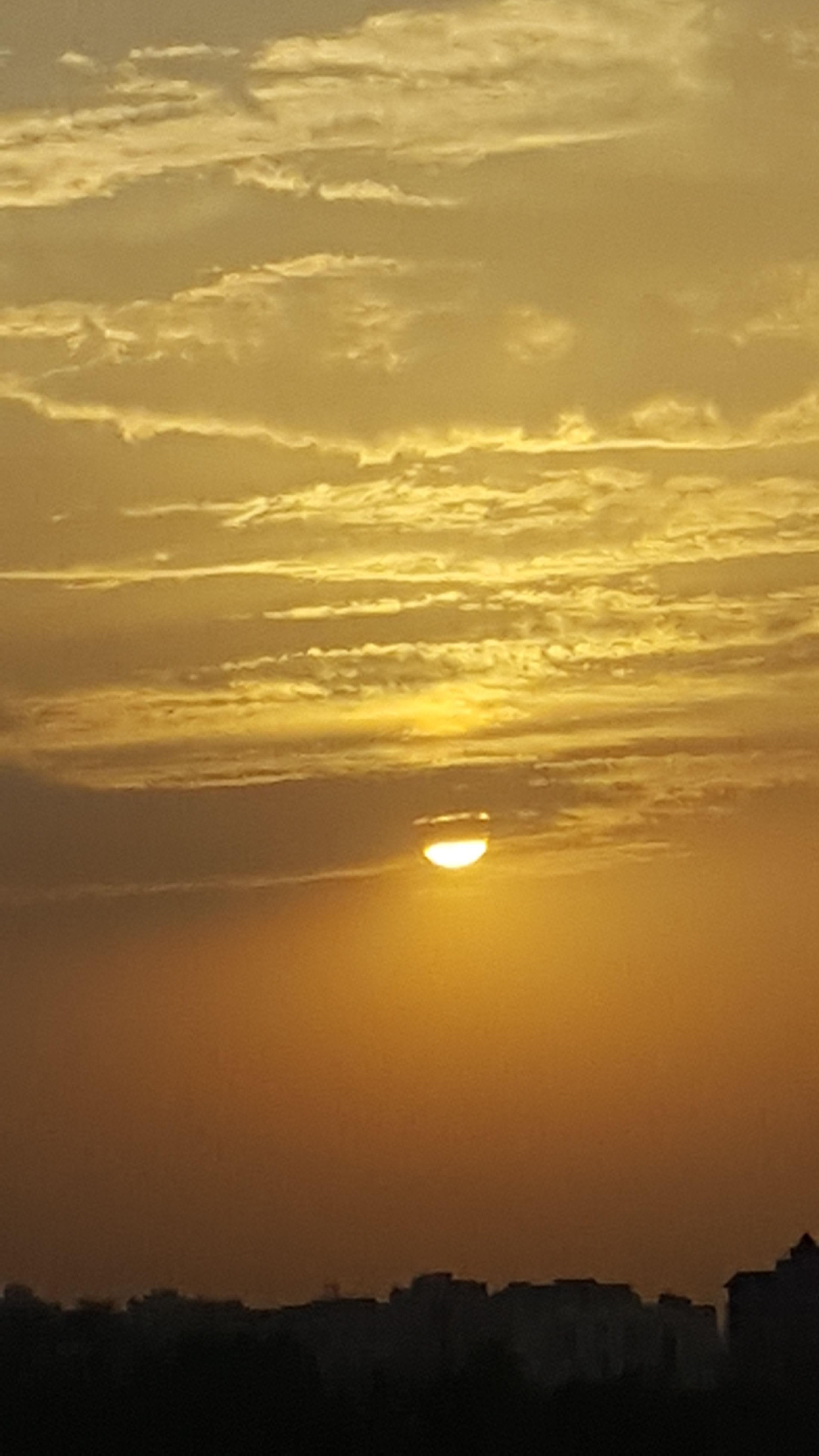 sunset, scenics, tranquil scene, tranquility, sea, beauty in nature, water, sky, nature, idyllic, silhouette, sun, horizon over water, beach, mountain, orange color, reflection, majestic, non-urban scene, outdoors