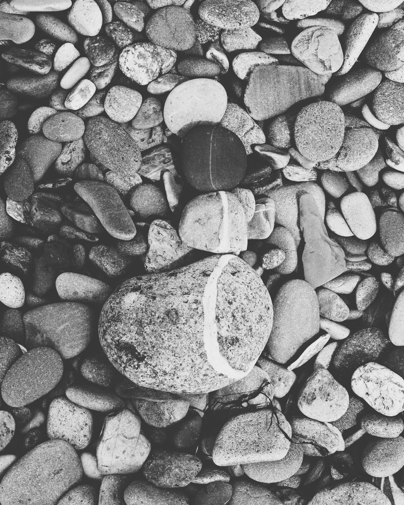 Pebbles on Newborough beach. Large Group Of Objects Pebble Abundance Full Frame Backgrounds Stack No People Day Beach Pebble Beach Outdoors Nature Close-up Blackandwhite Photography Greytones