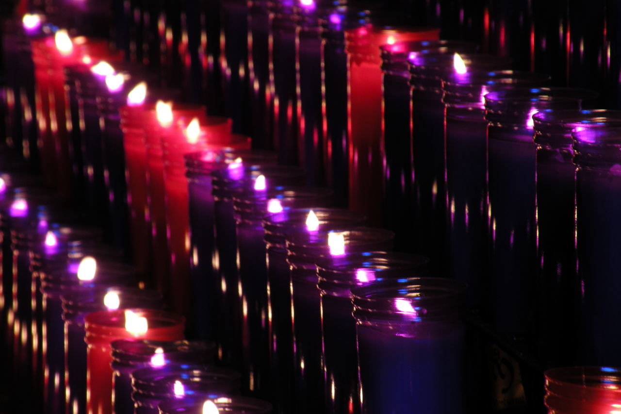 illuminated, candle, in a row, religion, glowing, spirituality, place of worship, night, lighting equipment, indoors, repetition, tea light, burning, flame, no people, heat - temperature
