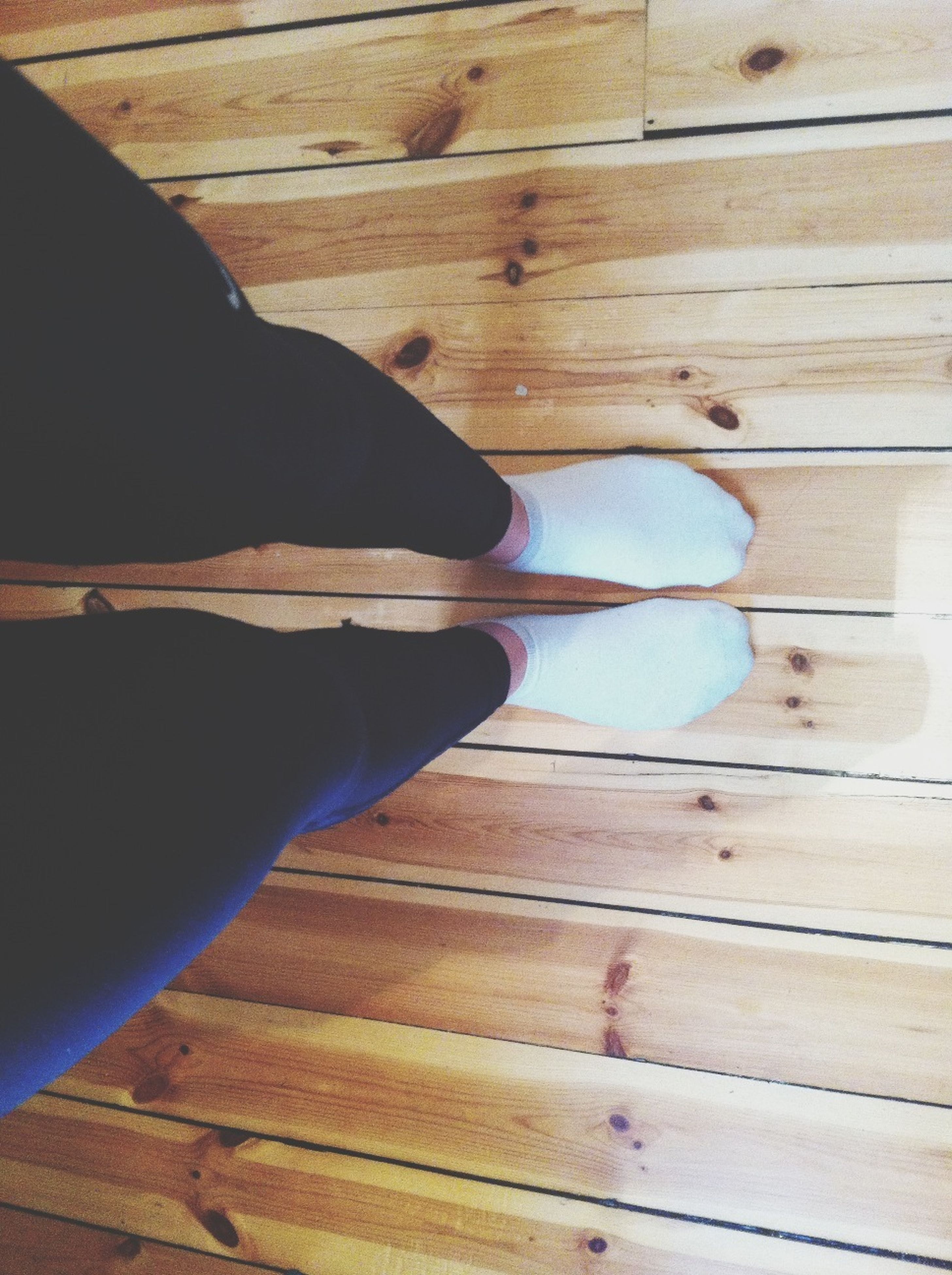 wood - material, indoors, low section, wooden, hardwood floor, person, part of, high angle view, plank, unrecognizable person, wood, personal perspective, shoe, close-up, human foot, men, shadow