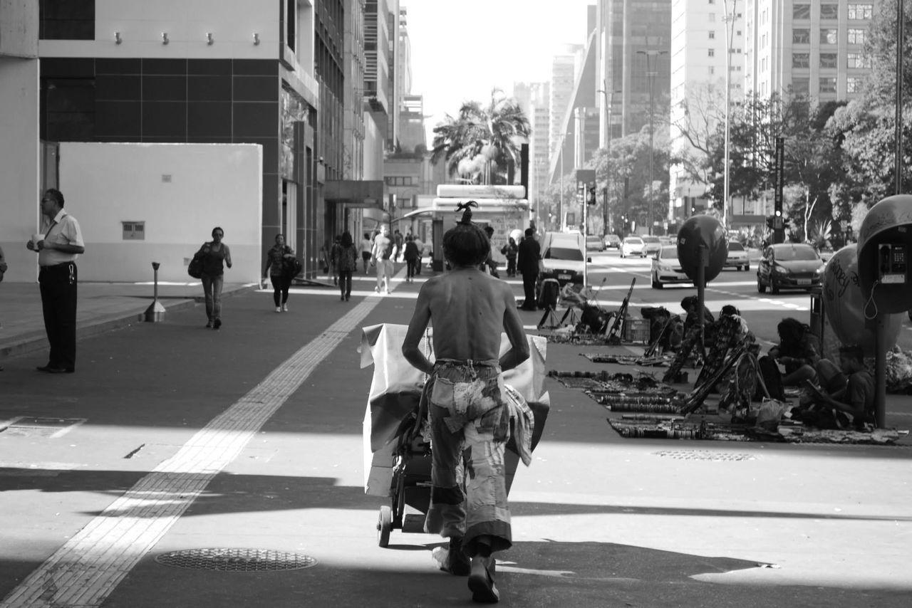 Man Pushing Push Cart In City