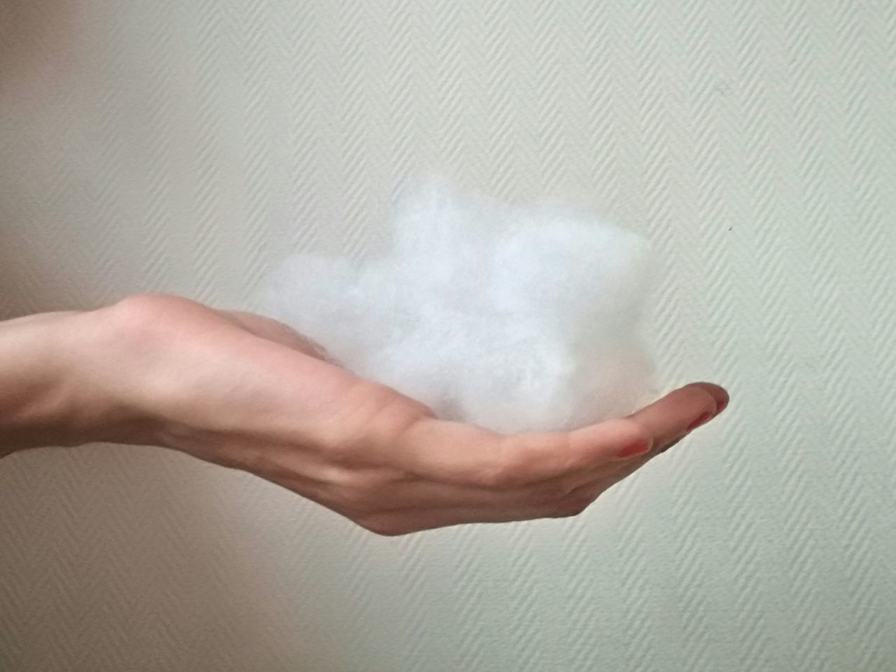 Human Hand Human Body Part One Person People Adults Only Indoors  Adult Day Natural Light Photography Imperfectly Perfect Pastel Colors Weather Weather Condition Symbolic  Soft Colors  Cloud Fluffy White On White Fluffy Clouds Cottoncandy Cotton Clouds Iconic Images  Backgrounds Dream Poetic Caption
