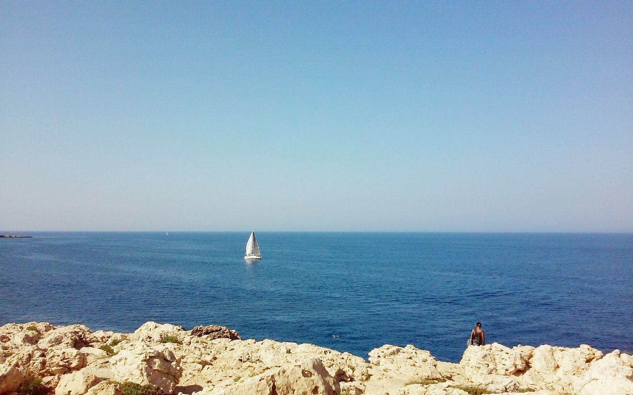 Clear Waters Minimal Minimalism Blue Sky Sailing Sails Boat Travel Photography Traveling People Rocks Blue Sea Horizon Over Water Concept Descovering Places