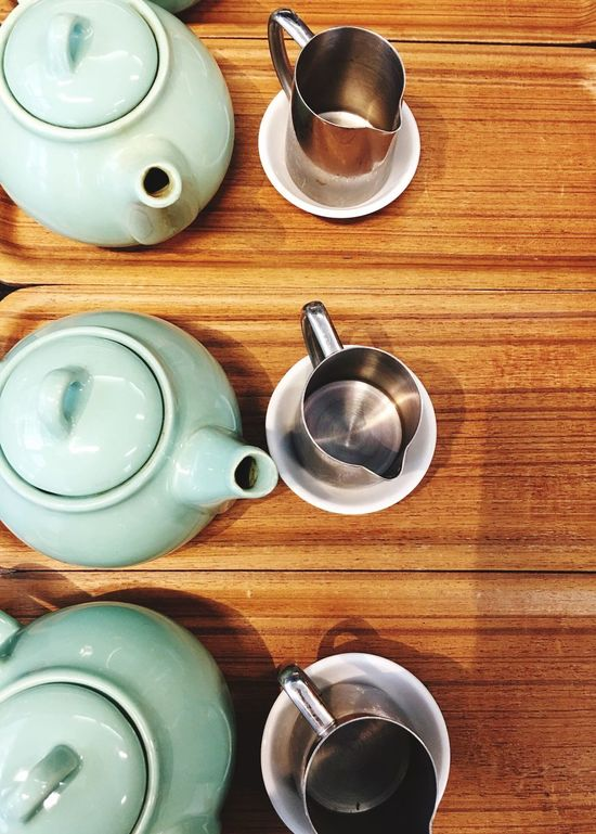 Cup of tea anyone Repetition In A Row Tea Pots Tea Cafe Elevated View
