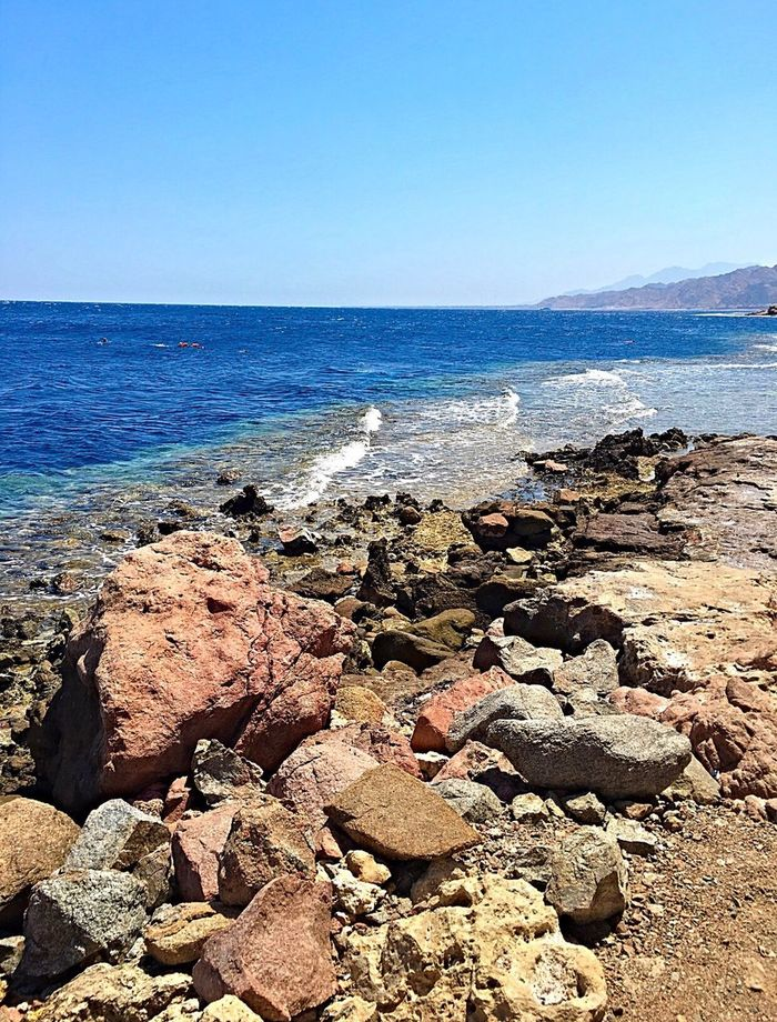 I need sea 🌊 Sea Beauty In Nature Rock - Object Water Horizon Over Water Clear Sky Sunlight Blue Southsinai Scenics 3pools Wunderlust Beach Nature Readsea RedSea Sea And Sky IPhoneography EyeEm Best Shots Thisisegypt Egypt Tourism Lifestyles Beauty In Nature