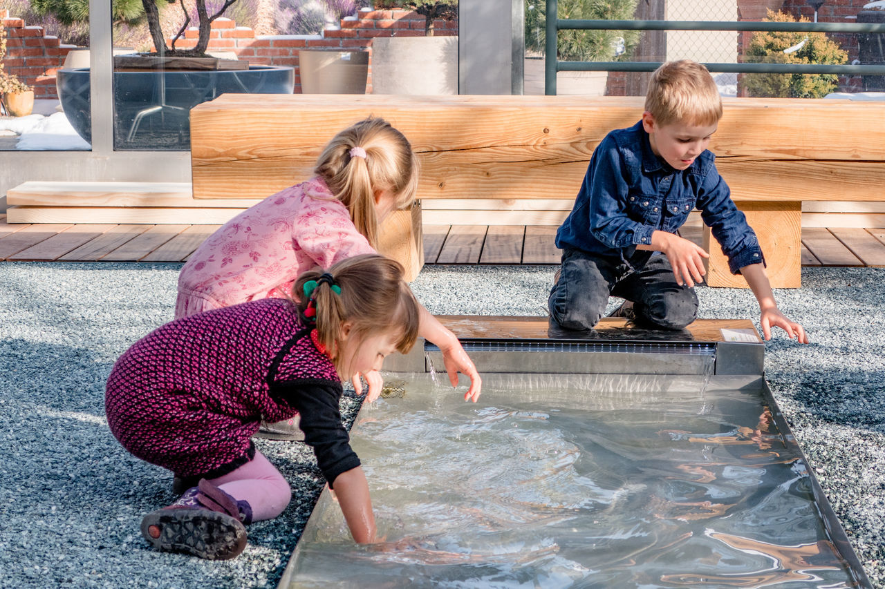 childhood, child, girls, togetherness, boys, real people, water, day, two people, full length, cleaning, females, indoors, blond hair, people, adult