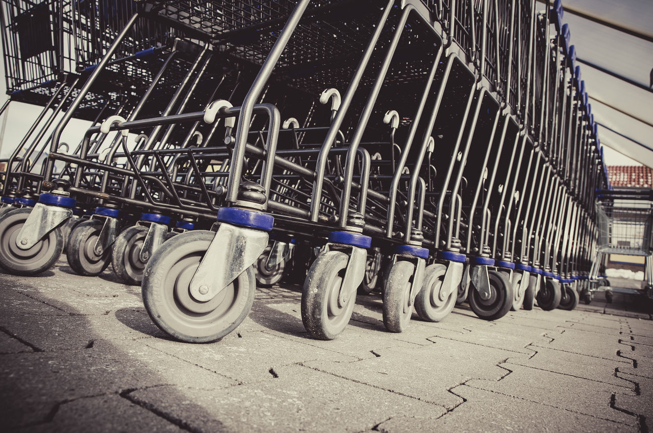 Row of shopping carts Carts Commerce Detail Row Shopping Shopping Carts Shopping Carts In A Row Street Urban Wheels