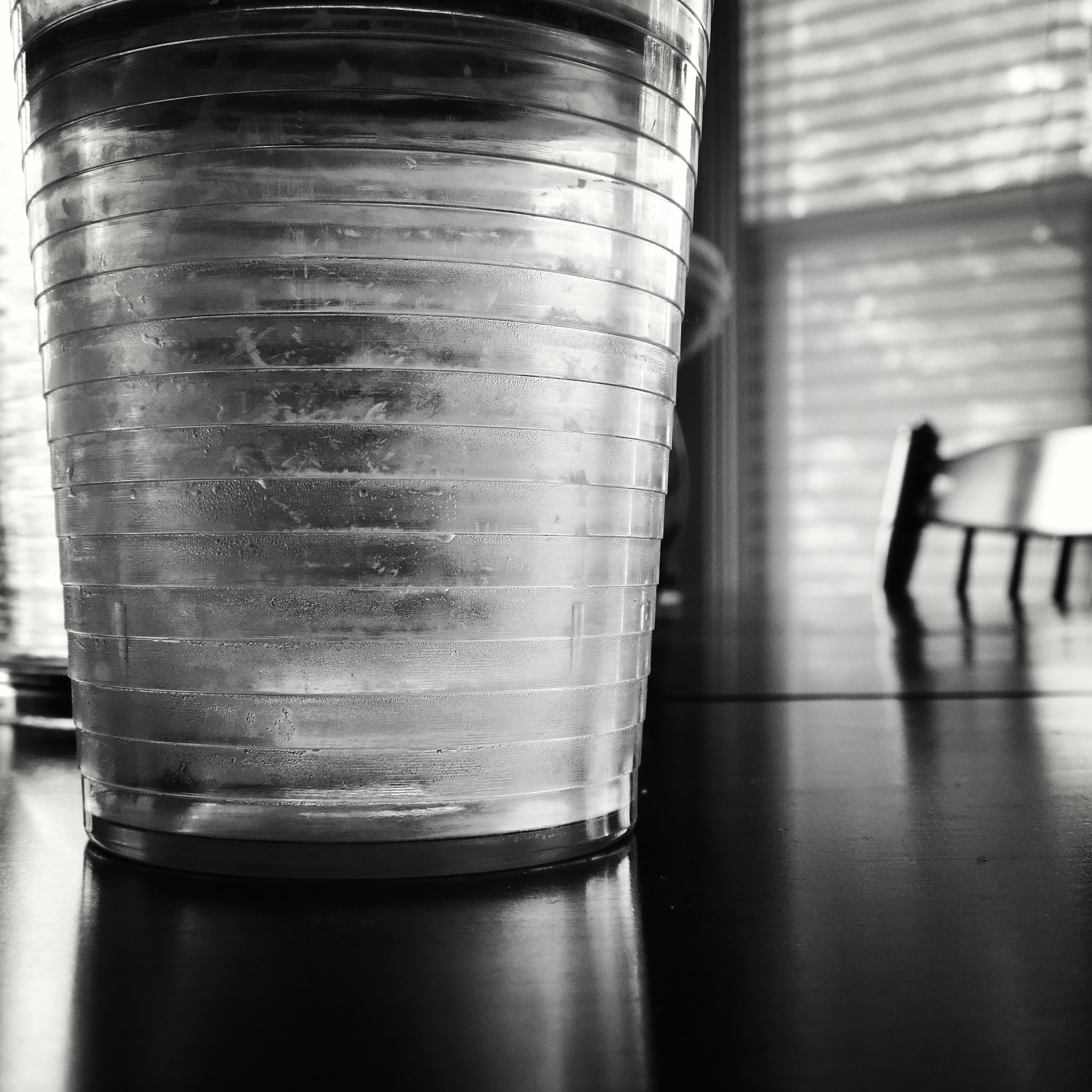 indoors, drink, table, food and drink, refreshment, close-up, drinking glass, still life, freshness, wood - material, focus on foreground, glass, glass - material, wooden, drinking straw, high angle view, no people, bottle, beverage, liquid