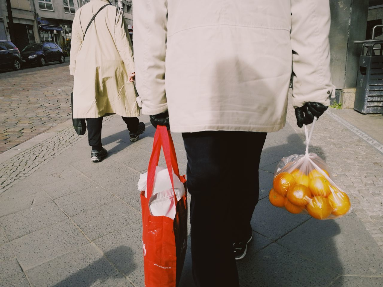 Midsection Of Man With Shopping Bags