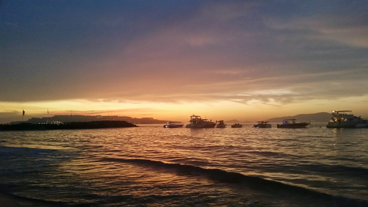 water, sunset, sea, nautical vessel, transportation, mode of transport, scenics, beauty in nature, sky, nature, tranquility, outdoors, no people, tranquil scene, silhouette, waterfront, cloud - sky, sailing, horizon over water, day