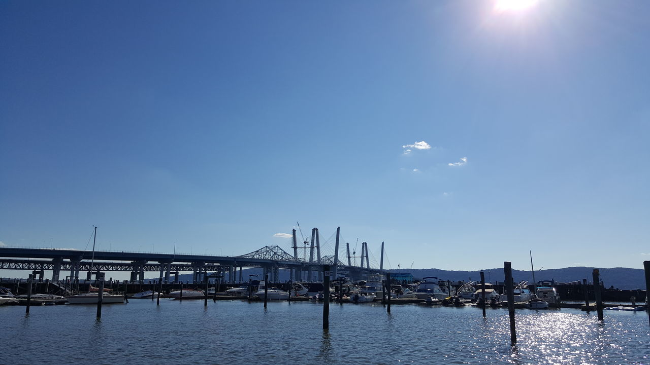 A perfect day at the Tarrytown, NY Marina. Tappan Zee Bridge sky Water Harbor Bridge - Man Made Structure No People Outdoors Blue Built Structure Sea Commercial Dock Architecture Travel Destinations Day Scenics Nature City Nautical Vessel Beauty In Nature Tall Ship Golf Club