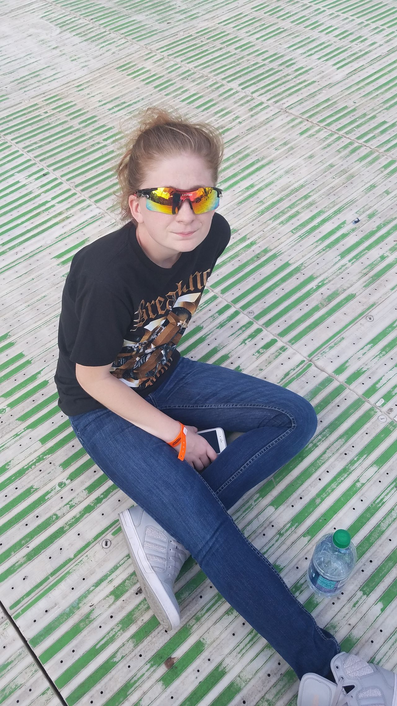 Sitting Casual Clothing Sunglasses Person Young Adult Rock N Roll Music Festival Enjoyment Green Color Resting