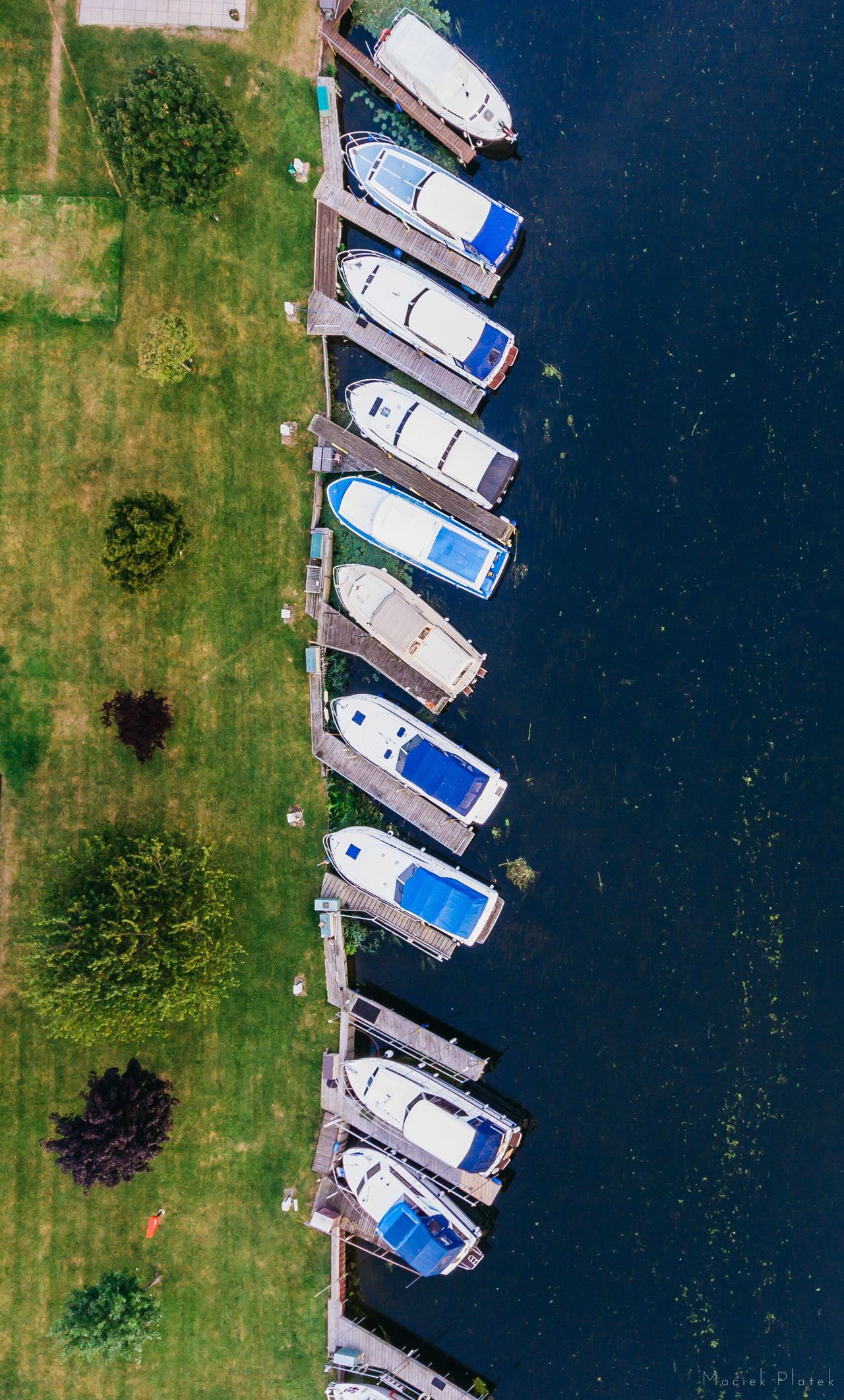 At the dock High Angle View Water Outdoors Architecture Field Building Exterior Nature Day Grass Scenics Growth Tranquility Aerial View Built Structure Beauty In Nature No People Sky Dronephotography Aerial Shot
