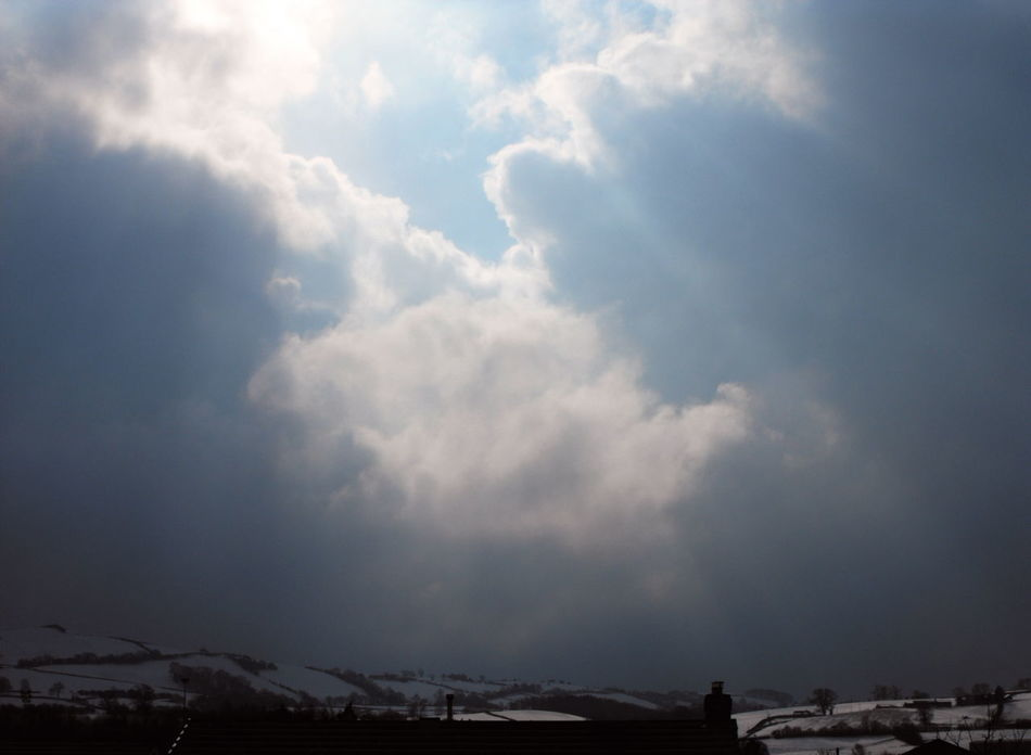 Winter's Splendour. Beams of sunlight breaking through clouds over snow-covered hills in Newtown, Powys. Beauty In Nature Beauty In Nature Cloud - Sky Day Hanging Out Hills Inspiration Landscape Love Mountain Nature No People Outdoors Powys Ray Of Sunshine Rays Scenics Sky Snow Storm Cloud Tranquil Scene Tranquility Wales Weather Winter