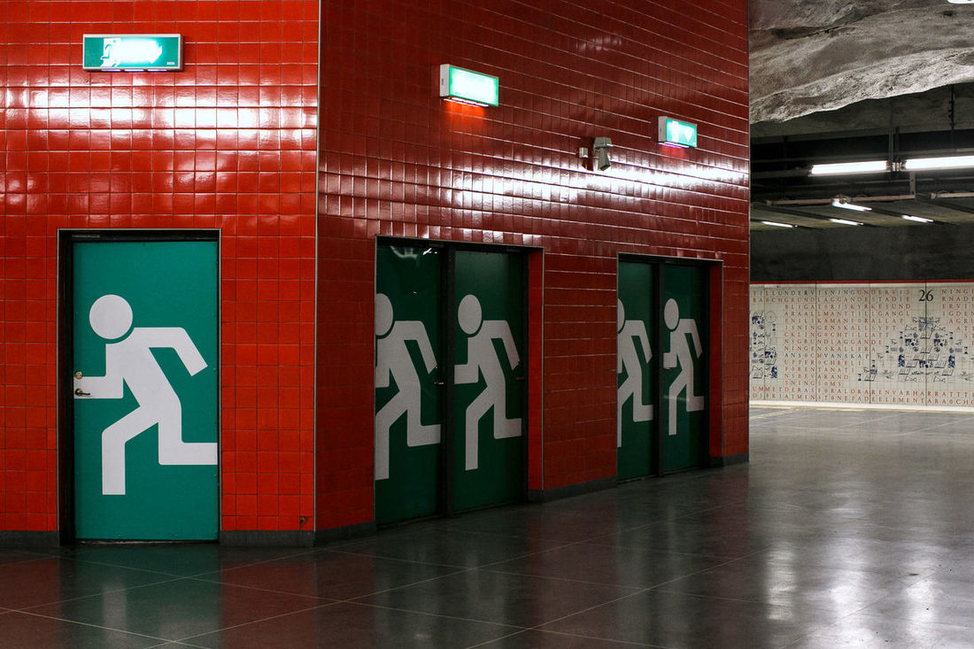 Universitet Station Green Color Moving Productivity Running Stockholm Metro Alphabet Architecture Built Structure Ceiling Communication Indoors  Lighting Equipment No People Red Color Text Underground