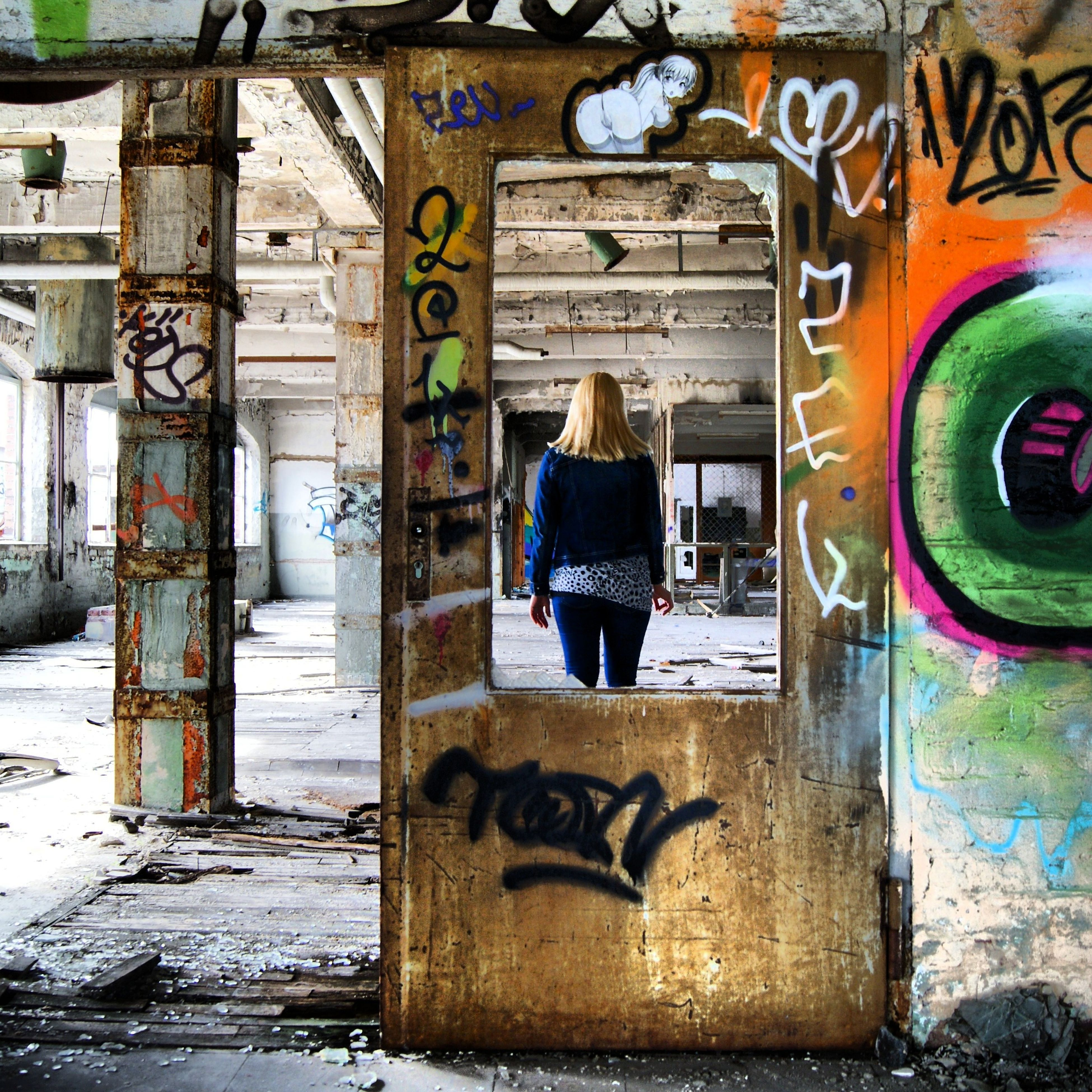 graffiti, text, western script, communication, built structure, architecture, art, wall - building feature, creativity, art and craft, building exterior, street art, wall, vandalism, non-western script, capital letter, day, no people, weathered, outdoors