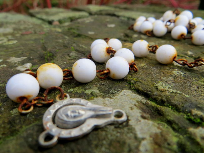 Lost and found, necklace for Mary Abundance Balance Close-up Field Focus On Foreground Ground Group Of Objects High Angle View Holy Mary Large Group Of Objects Lost And Found Nature Neckalace  Necklaces Outdoors Pattern Pieces Pattern, Texture, Shape And Form Rust Rusty Selective Focus Still Life Stone - Object Sunlight Surface Level Textured