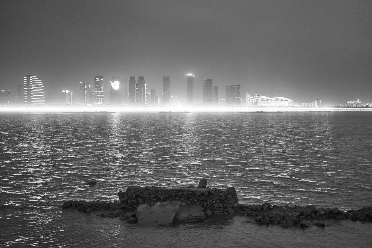 Hangzhou skyline on a foggy autumn day, viewed across the LED illuminated river Architecture Autumn Blackandwhite Building Exterior Built Structure City Cityscape Fog No People Outdoors Reflection River Skyscraper Urban Skyline Water