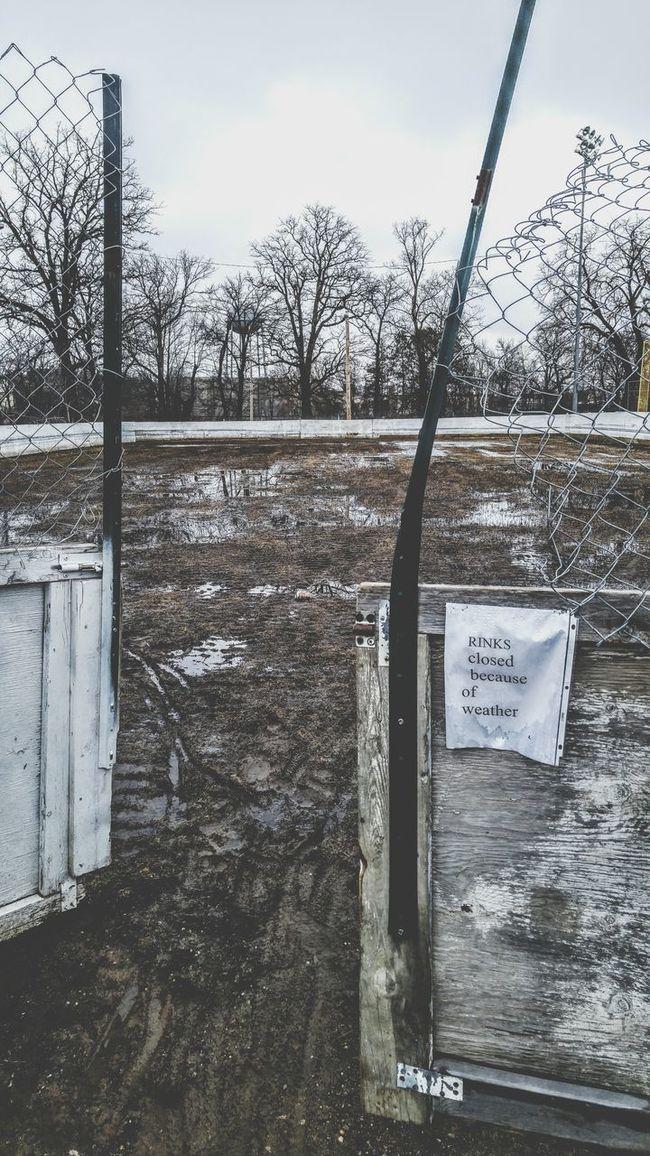 Smalltownusa Minnesota Aitkin Melting Ice Spring Is Coming  HockeyRink Raw Gray Sky Muddy Rink