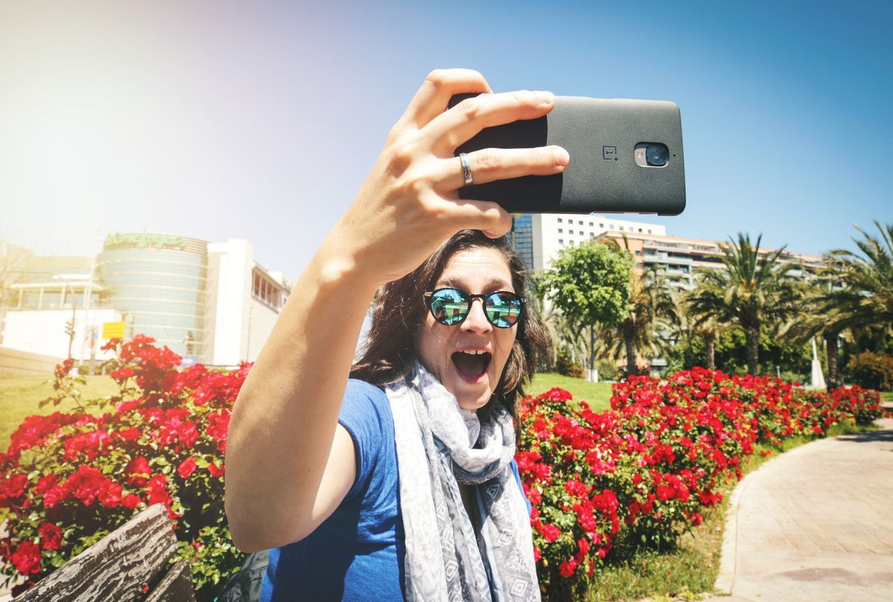 Photographing Selfie Self Portrait Photography Holding Outdoors Lifestyles Leisure Activity Day Portrait Flower Tree Technology Photography Themes Front View Real People Built Structure One Person Building Exterior Architecture Wireless Technology Valencia, Spain