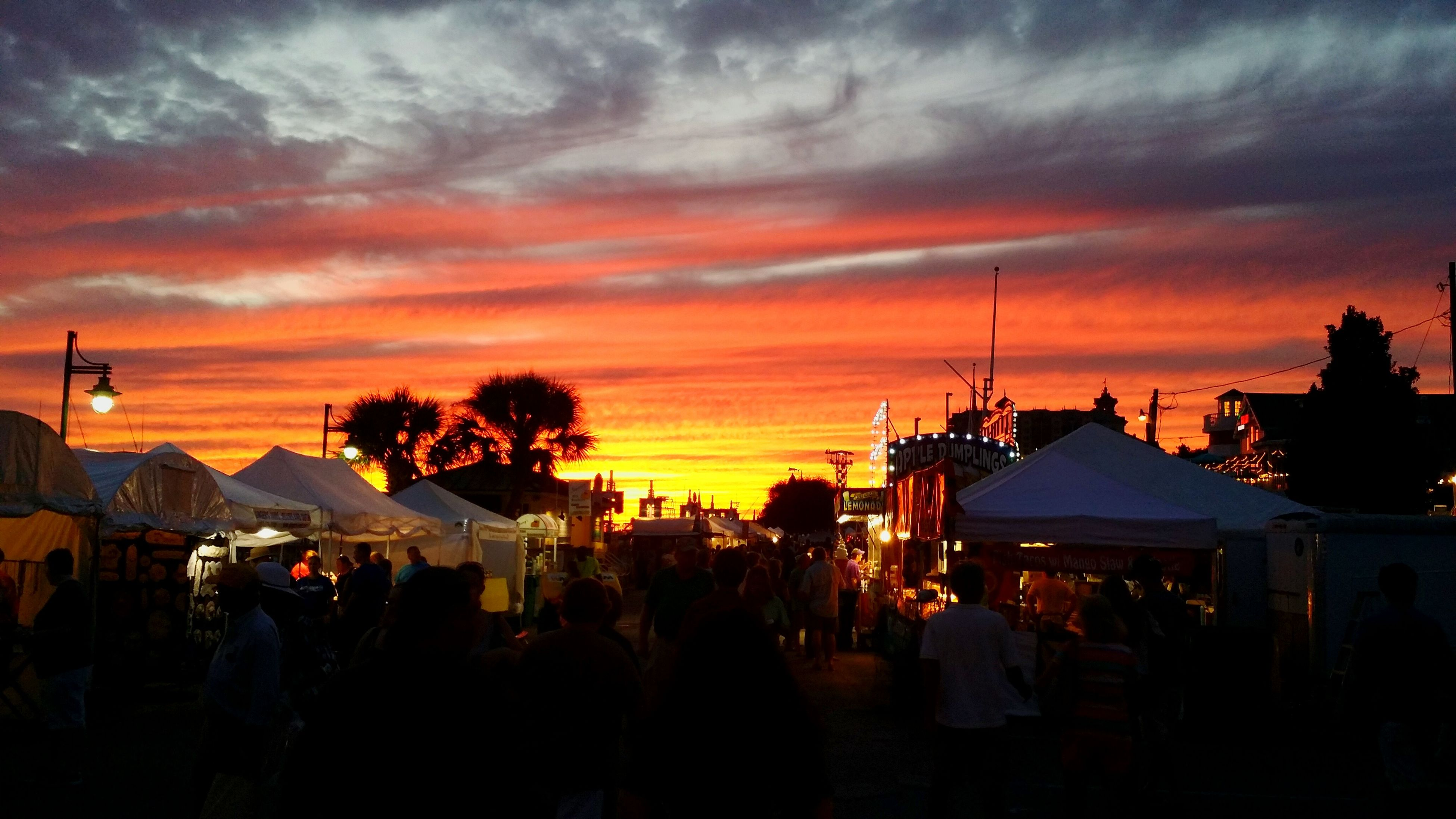 sunset, sky, large group of people, building exterior, silhouette, cloud - sky, architecture, built structure, orange color, person, men, illuminated, dusk, lifestyles, tree, cloud, street light, city, street