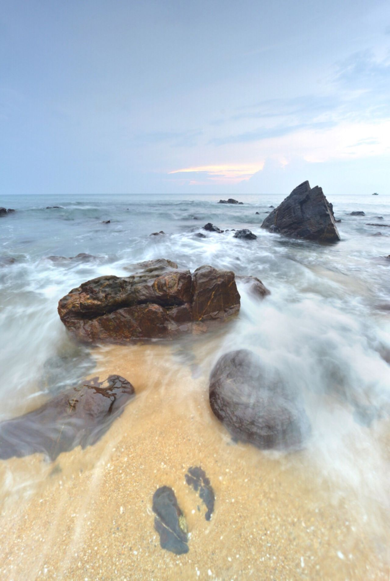 Sea Horizon Over Water Sky Beauty In Nature Beach Nature Scenics Water Rock - Object Tranquility No People Sand Wave Outdoors Day