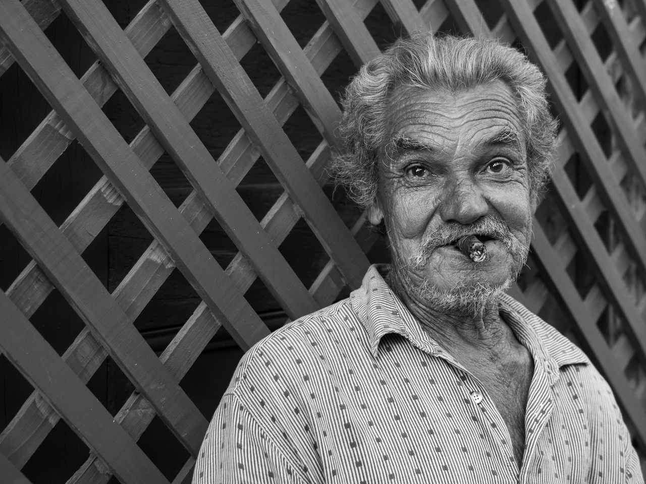 After making his acquaintance, this gentleman was more than willing to pose for my camera. Adult Adults Only Black And White Cigar Close-up Cuba Day EyeEm Best Shots Father's Day Gray Hair Headshot Looking At Camera One Man Only One Person One Senior Man Only Only Men Outdoors People Portrait Real People Retired Senior Adult Smoking The Portraitist - 2017 EyeEm Awards Trinidad