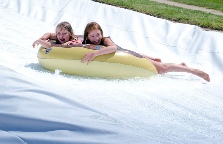 Aug 5, 2017 Buchanan MI usa; Active kids have fun in the sun during the Thrill on the hill event that takes place every summer on the main street of this small Michigan town. wild wet fun! Children Event Happy Kids Messy Michigan Sliding Summertime USA Water Slide Bathing Suits Childhood Day Editorial  Fun Man Made Object Rafts Shorts Summer Thrill On The Hill Water Wet