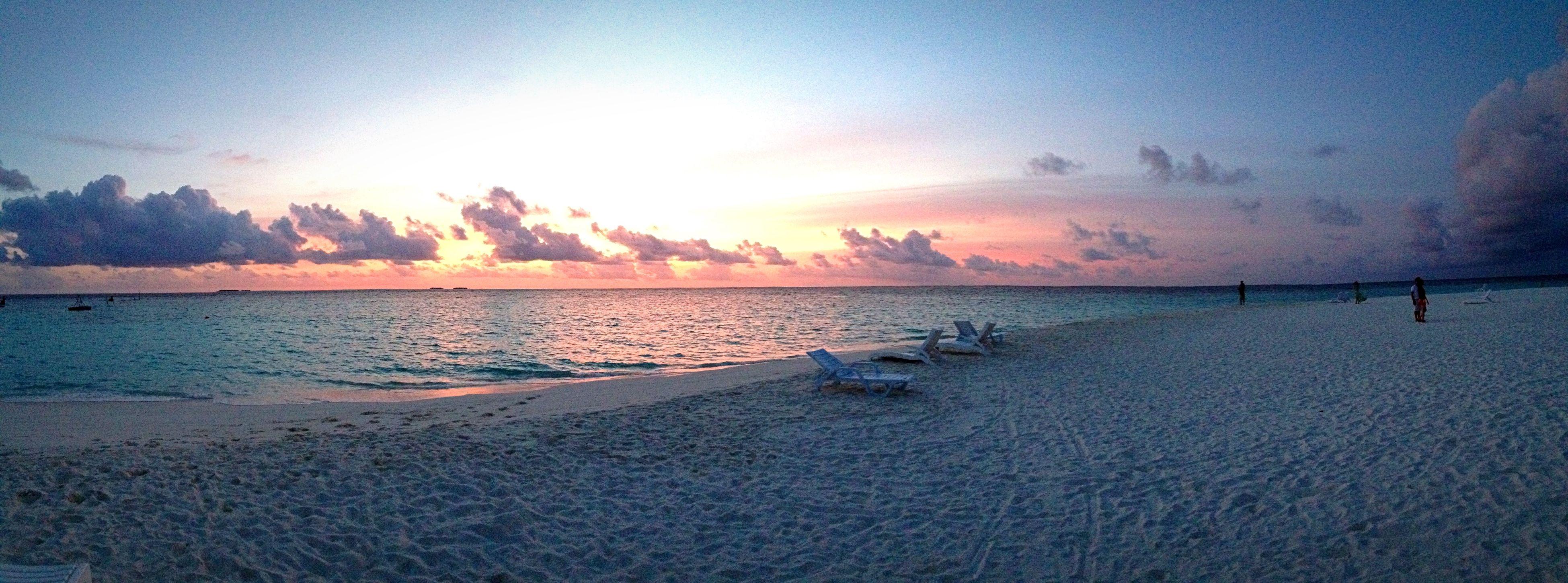 water, sunset, tranquil scene, scenics, tranquility, sea, beauty in nature, sky, beach, nature, shore, idyllic, sun, cloud - sky, sand, non-urban scene, horizon over water, sunlight, reflection, remote