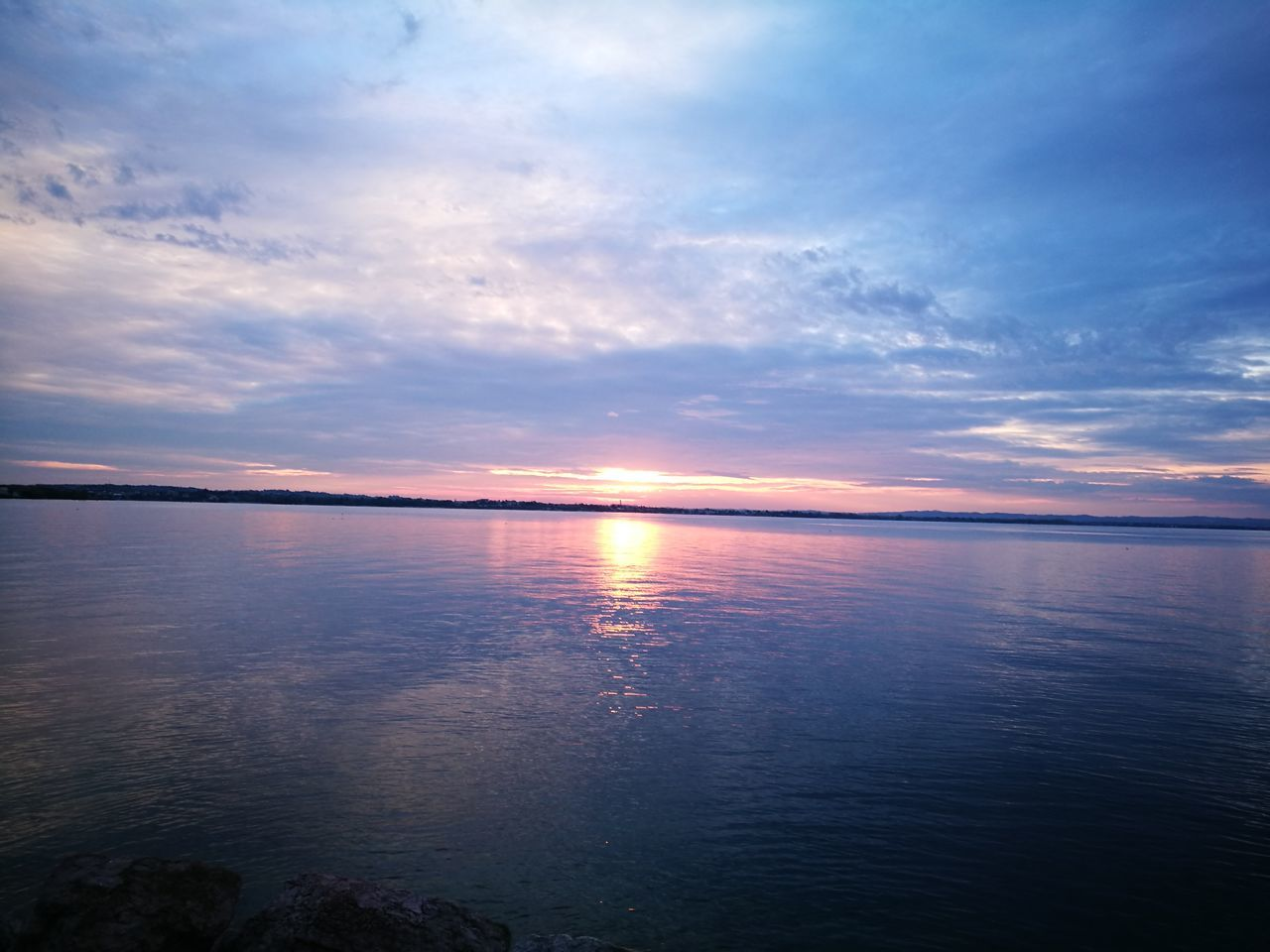scenics, sunset, beauty in nature, tranquility, nature, water, tranquil scene, sky, reflection, idyllic, sea, cloud - sky, no people, outdoors, waterfront, horizon over water, day