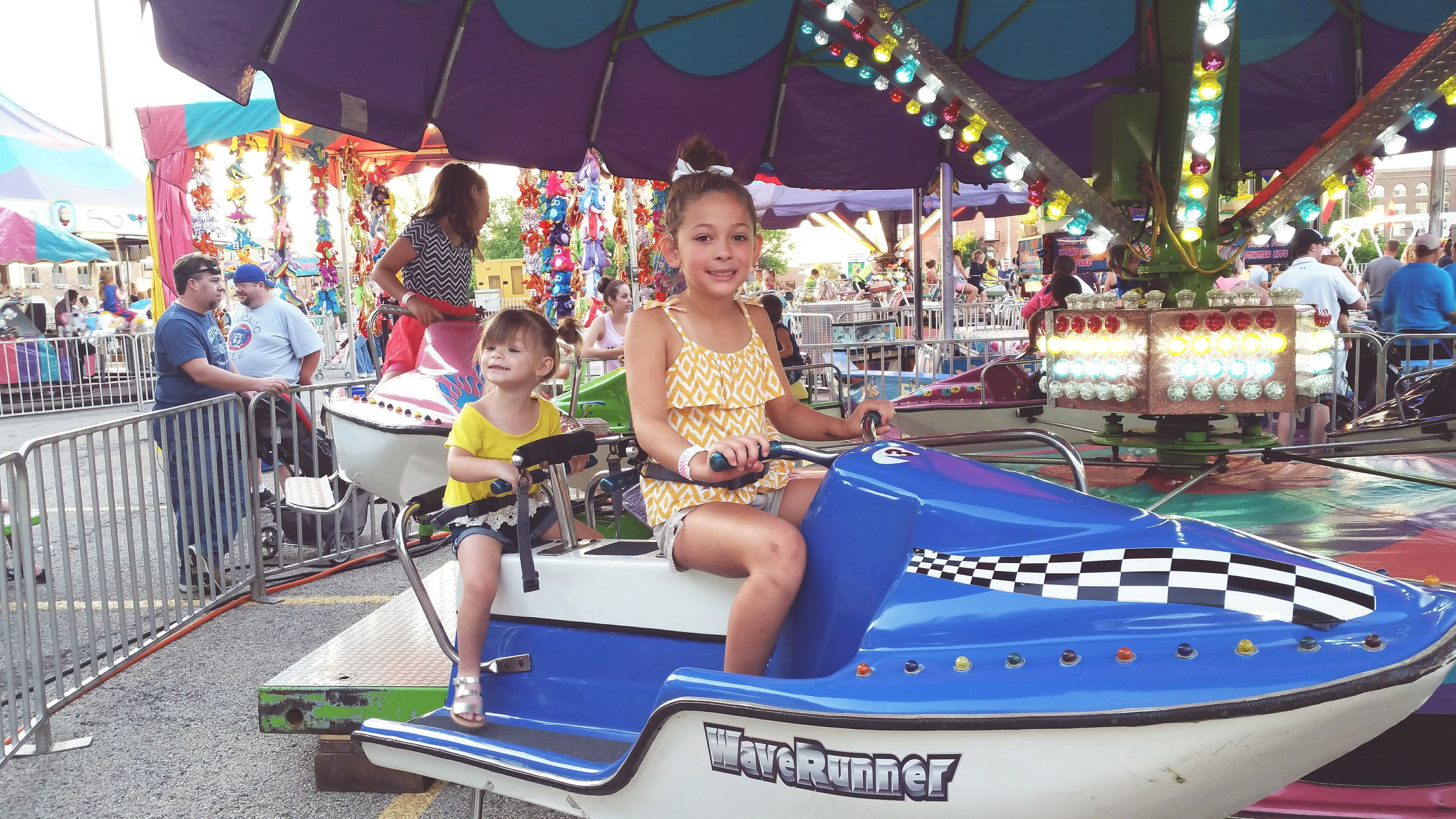 leisure activity, childhood, arts culture and entertainment, lifestyles, animal representation, amusement park, sitting, fun, retail, carousel, multi colored, tradition, incidental people, amusement park ride, casual clothing, enjoyment, cultures, art and craft