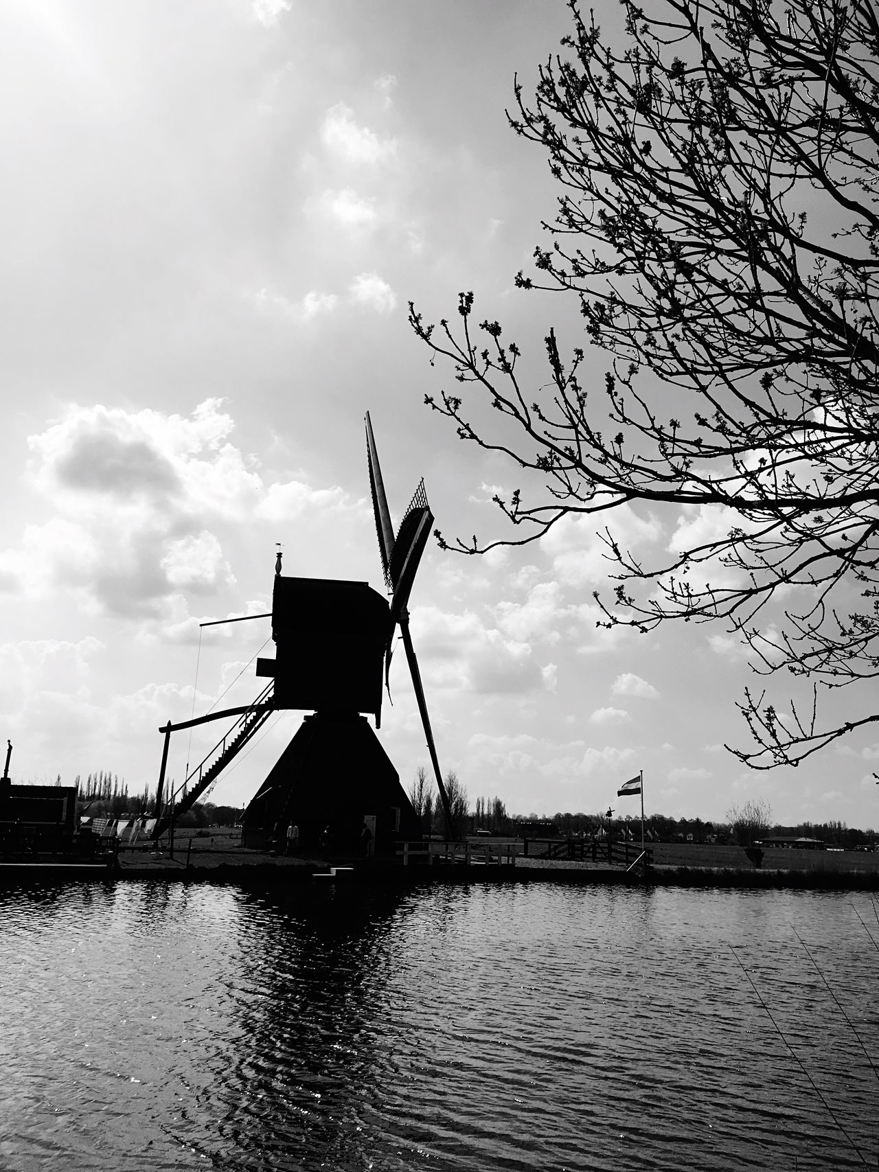 Sky Water Tree Cloud - Sky Built Structure Nature Outdoors Waterfront River Silhouette No People Windmill Architecture Wind Turbine Building Exterior Nautical Vessel Day Beauty In Nature Alternative Energy Welcome To Black