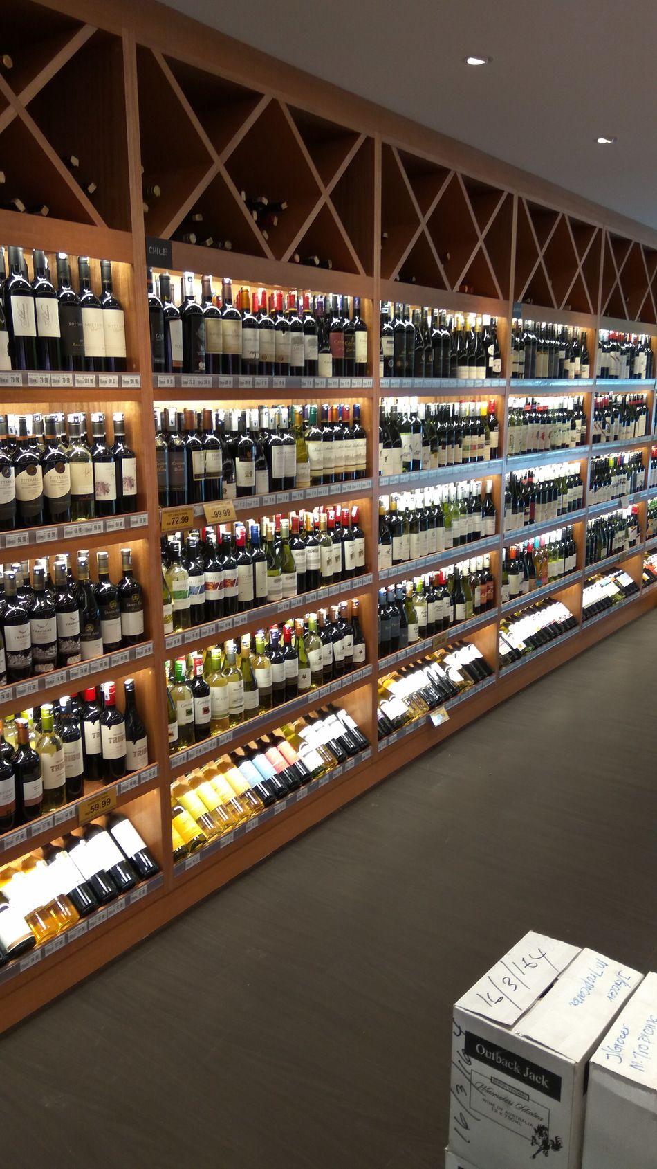 Bottle Choice Abundance Wine Bottle Shelf Indoors  Store In A Row Liquor Store Wine Wine Rack Retail  Eyeemphotography EyeEmBestPics Whats Good? Spoilt For Choice