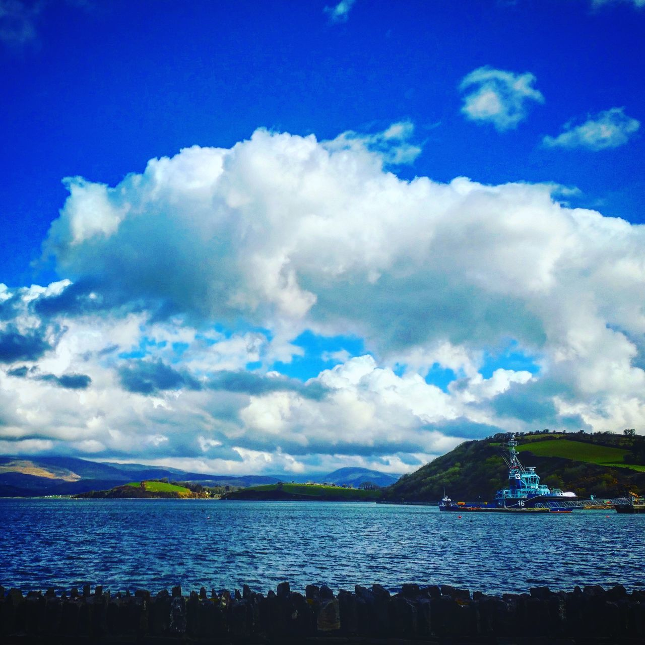 sky, cloud - sky, scenics, beauty in nature, tranquility, water, tranquil scene, nature, sea, mountain, outdoors, blue, nautical vessel, idyllic, day, no people, travel destinations