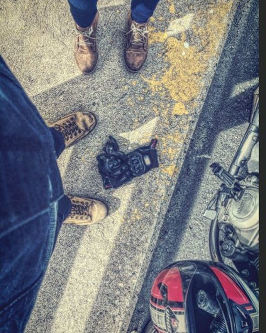 low section, shoe, human leg, human body part, high angle view, street, day, standing, outdoors, road, real people, men, people, one person, adult, adults only, only men, one man only