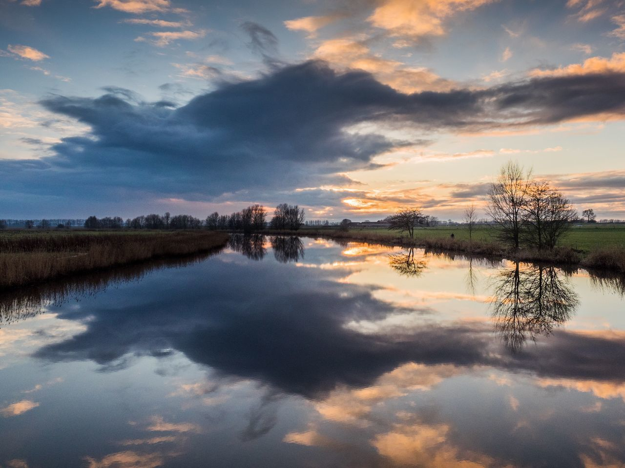 reflection, water, cloud - sky, sky, tranquility, nature, tranquil scene, scenics, beauty in nature, standing water, lake, outdoors, no people, waterfront, sunset, symmetry, tree, day