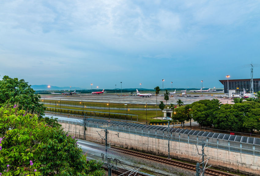 Airport Airport Beauty In Nature Blue Cloud Cloud - Sky Day Development Formal Garden Green Green Color Growth Hedge Nature Night No People Outdoors Plant Scenics Sky Tranquil Scene Tranquility Tree Wide Shot