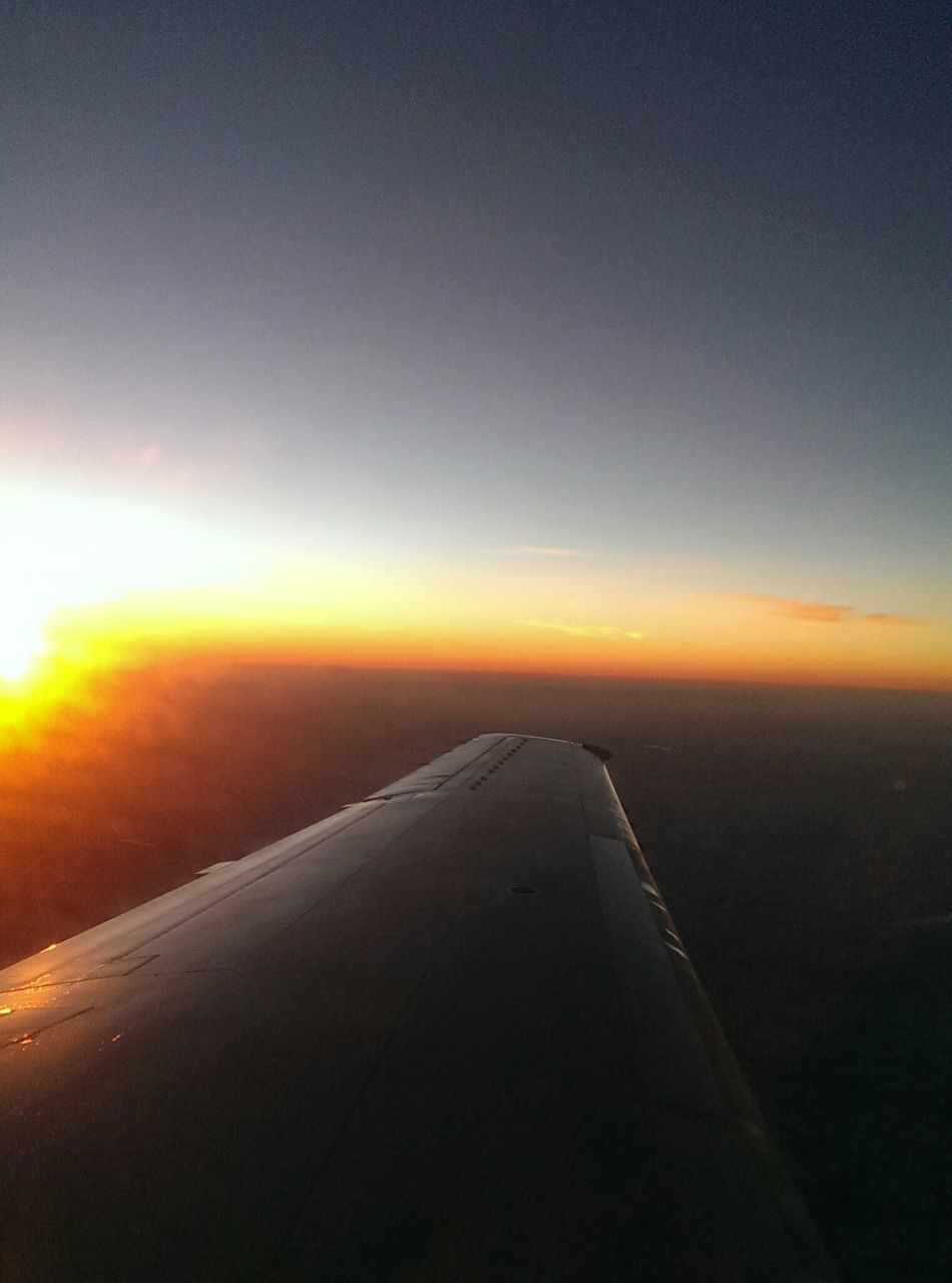 airplane, transportation, sunset, journey, travel, air vehicle, airplane wing, nature, sky, no people, aircraft wing, scenics, mode of transport, aerial view, sun, tranquility, outdoors, landscape, flying, beauty in nature, close-up, day