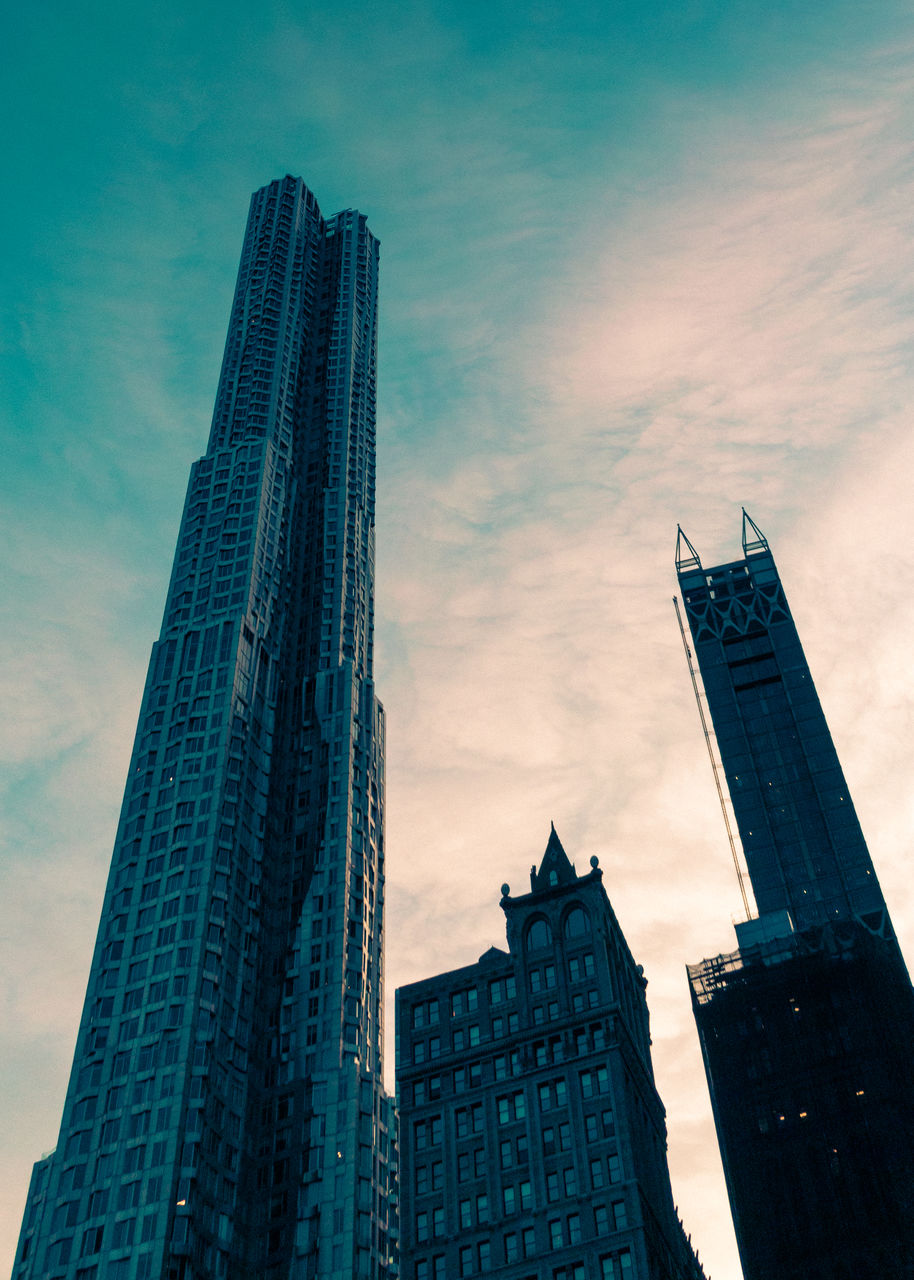 architecture, built structure, building exterior, tower, skyscraper, tall - high, low angle view, modern, city, sky, tall, development, no people, travel destinations, day, outdoors, urban skyline, cityscape