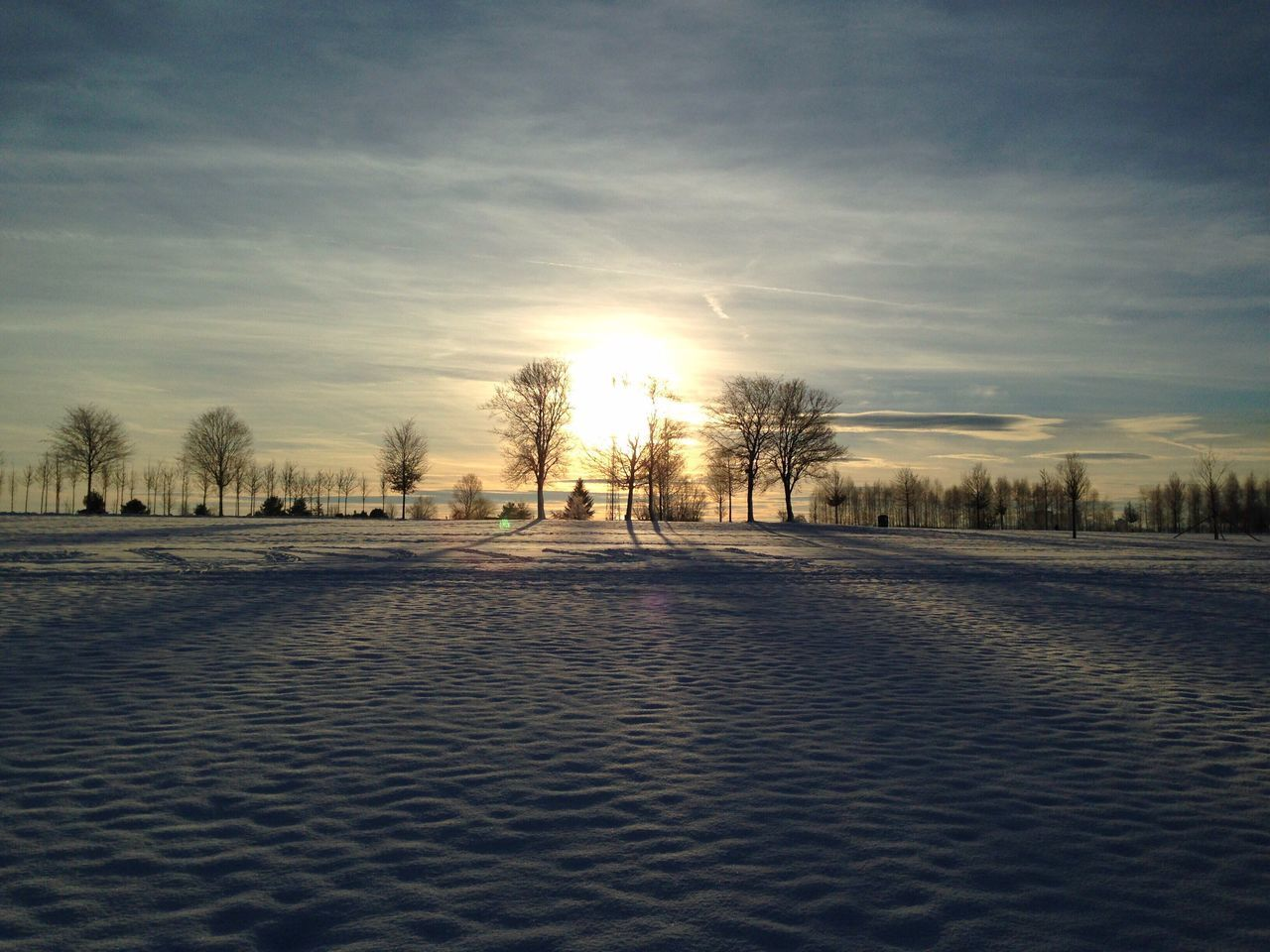 cold temperature, winter, snow, tree, nature, sky, weather, outdoors, sunset, scenics, tranquility, sun, beauty in nature, landscape, tranquil scene, no people, cloud - sky, bare tree, day