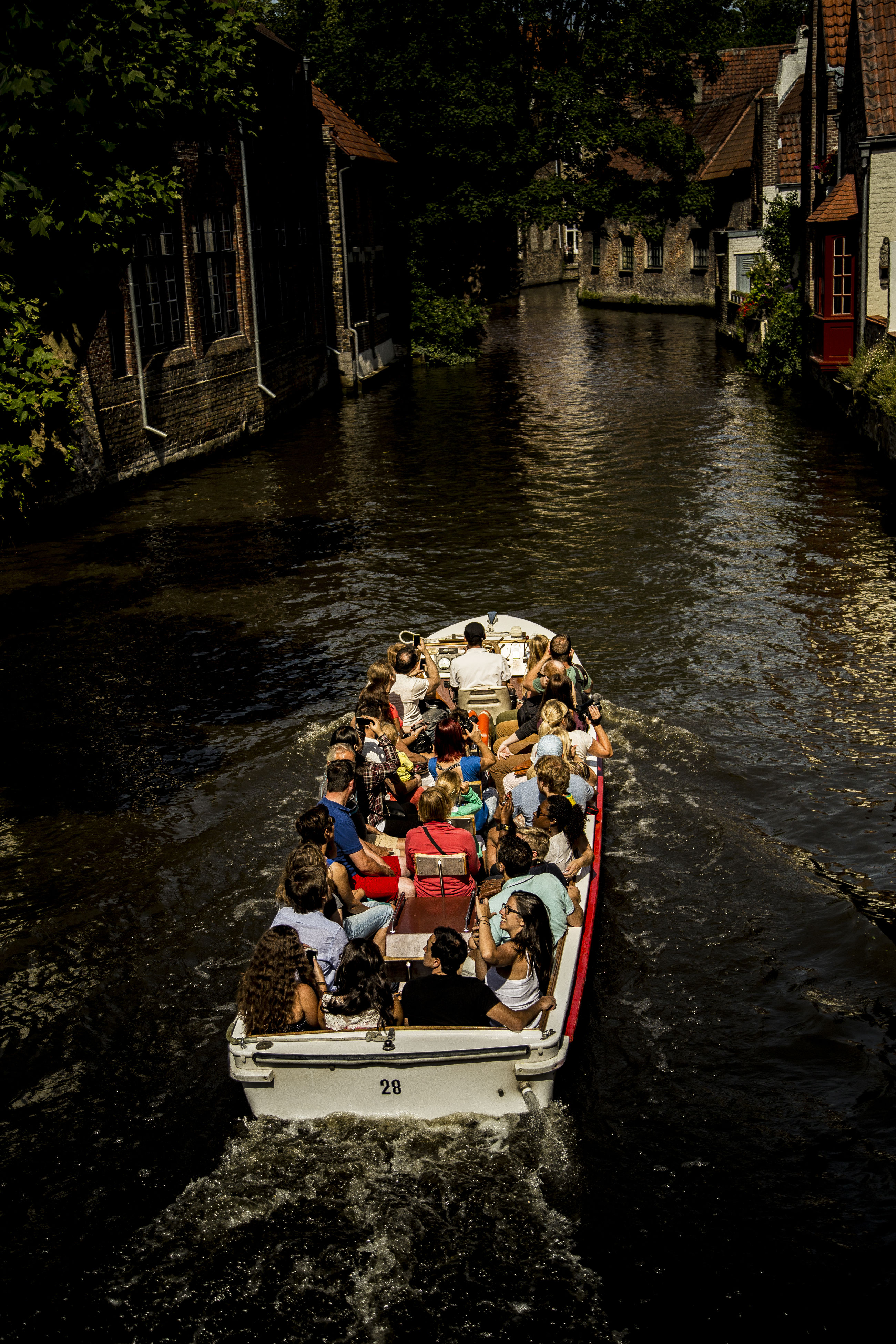 High Angle View Of People Travelling In Boat
