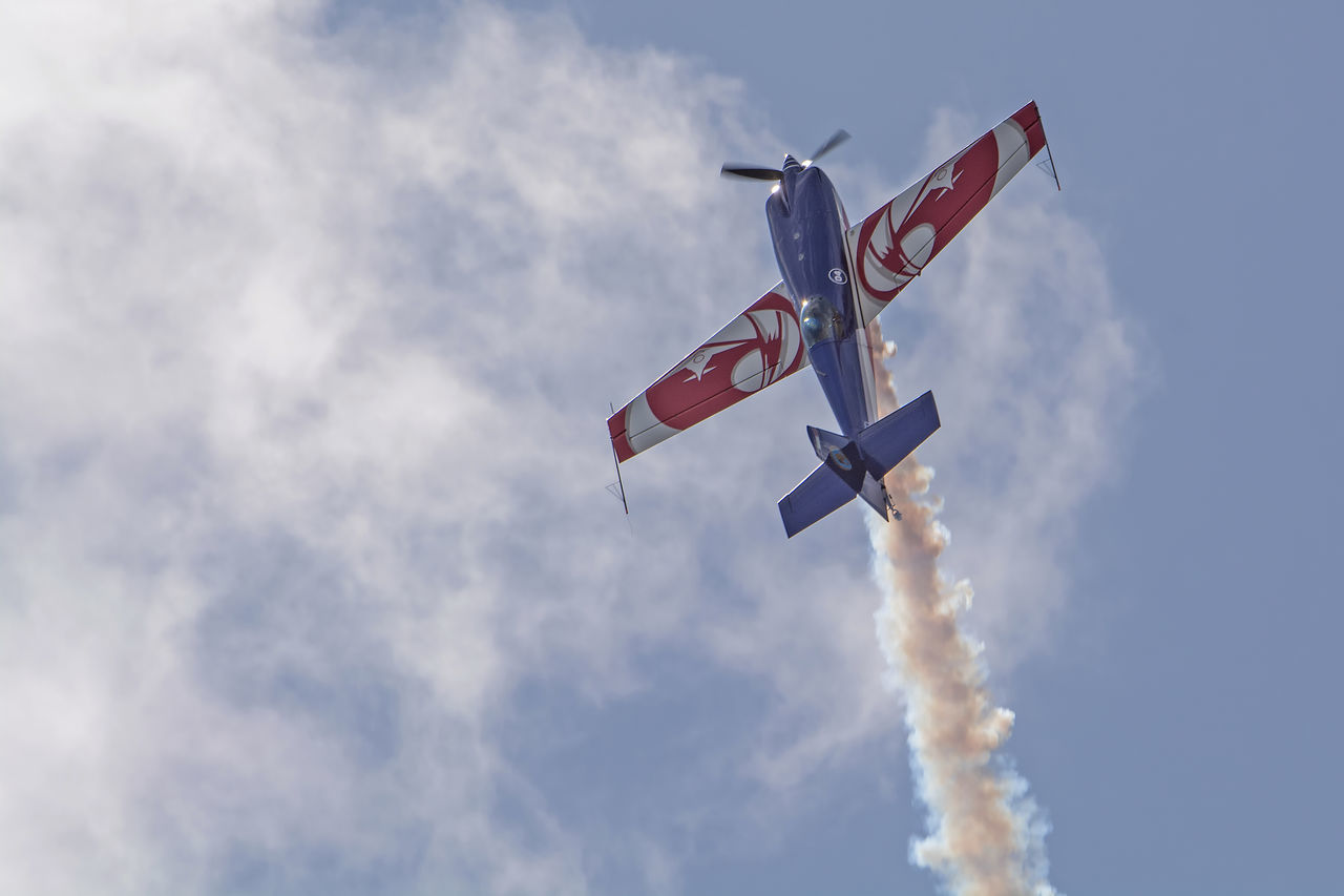 Aircraft Airplane Airshow Avion Blue Cloud Cloud - Sky Cloudy Culture Day Extra EA-330SC Flight Flying Flying Spirit à Biscarrosse 2016 Freedom Low Angle View No People Outdoors Pole Pride Shopping Sky Smoke - Physical Structure Sport Wind