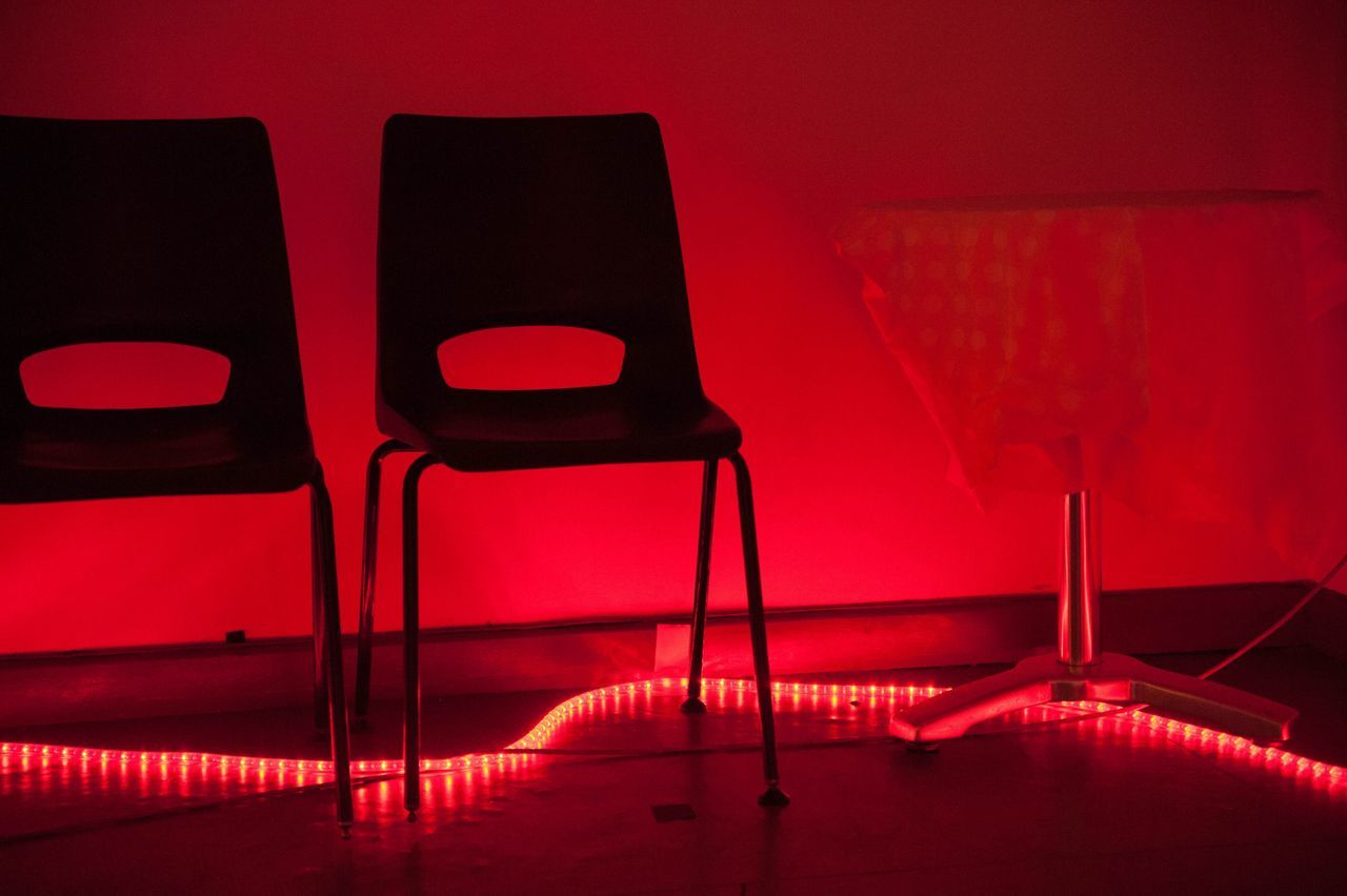 chair, red, indoors, empty, absence, no people, illuminated, seat, film industry