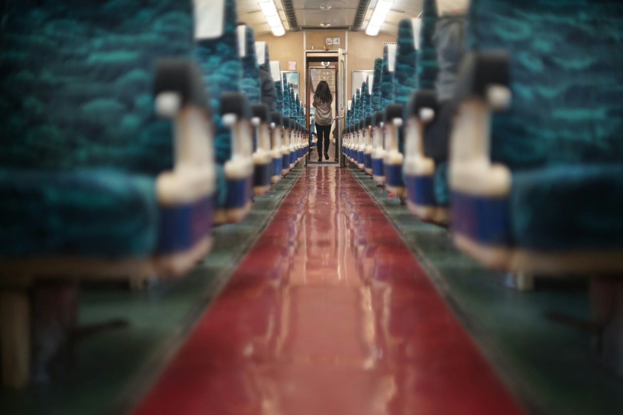 Miles Away The Way Forward Illuminated Indoors  In The Train Train Interior Railaway Train Tracks To No Where Vanishing Point Endless Roads  Getting Inspired Empty Seats