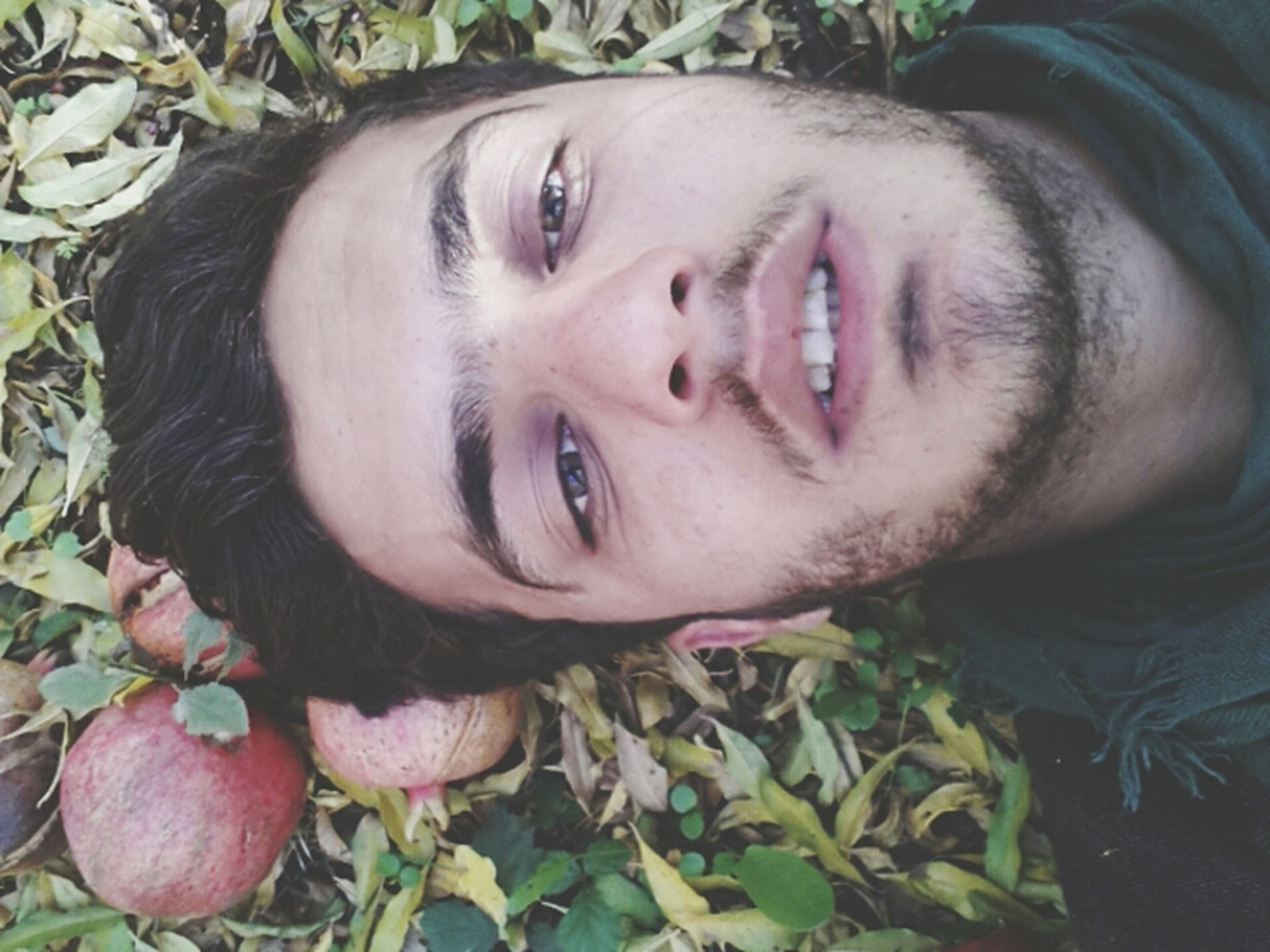 portrait, looking at camera, lifestyles, person, leisure activity, headshot, young adult, front view, high angle view, leaf, close-up, smiling, relaxation, day, casual clothing, nature, outdoors, growth
