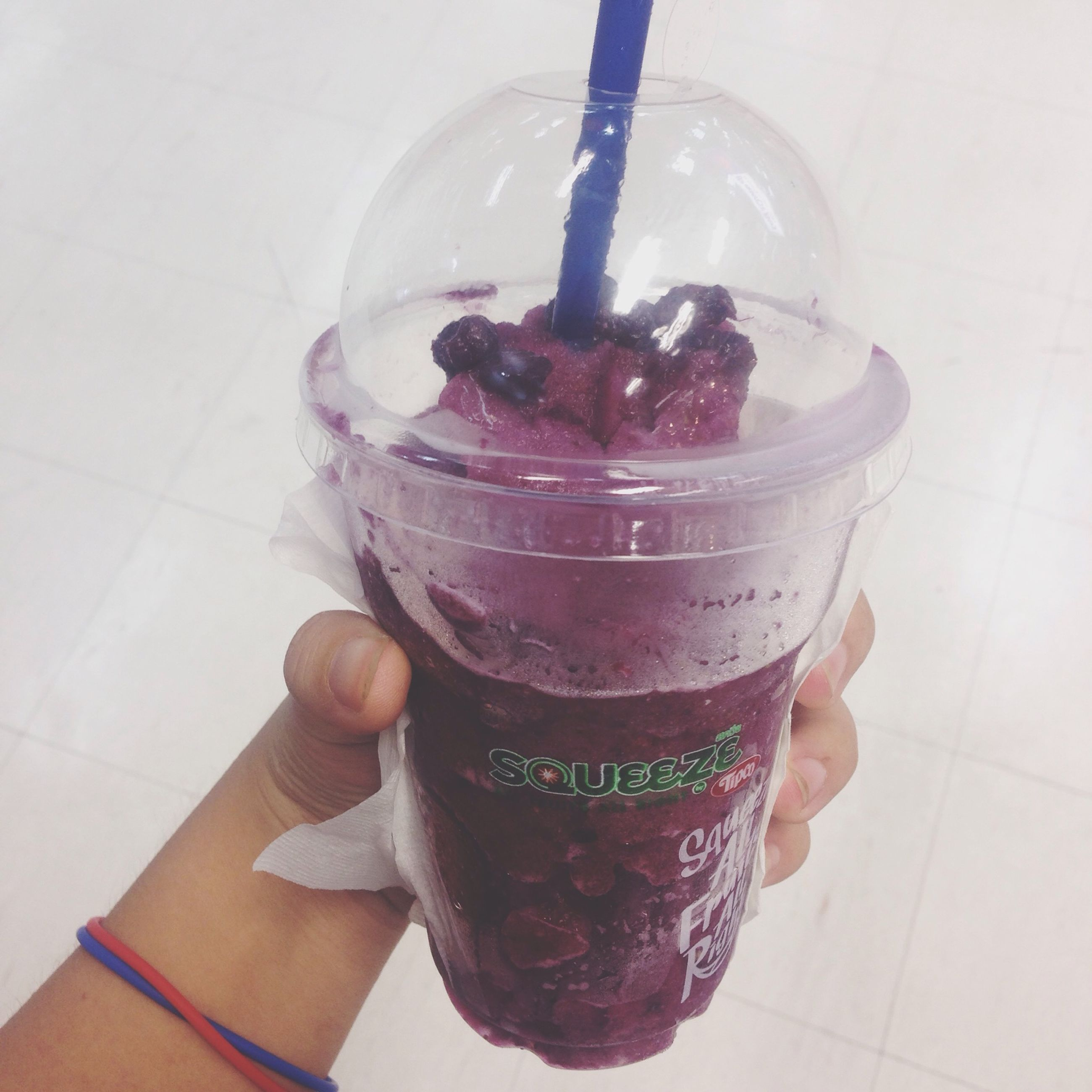 food and drink, freshness, sweet food, food, person, refreshment, drink, indoors, ice cream, dessert, indulgence, holding, frozen food, unhealthy eating, drinking glass, cold temperature, close-up
