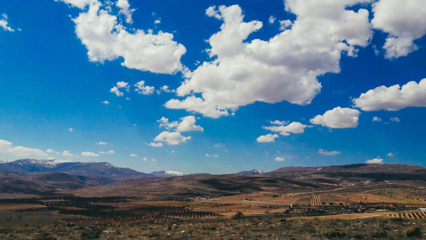 EyeEm Selects Mountain Cloud - Sky Landscape Sky Nature Blue Mountain Range Scenics Day No People Beauty In Nature Rural Scene Clouds Cloud Town TOWNSCAPE Photographer Photography Field Farm Canon